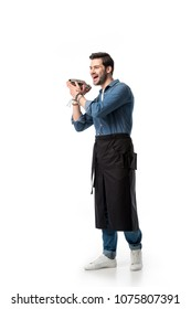 cheerful bartender in apron with shaker in hands isolated on white