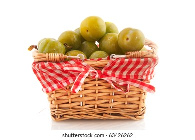 Cheerful basket full with fresh Reine claude plums