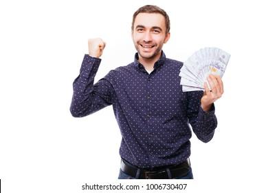 Cheerful bearded man in plaid shirt holding dollar bills over white
