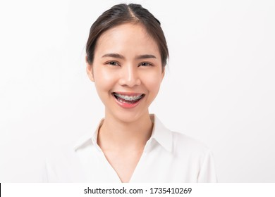 Cheerful beautiful Asian woman stand and smile on white background.