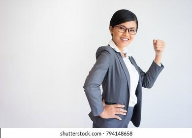 Cheerful Beautiful Business Woman Pumping Fist