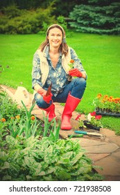 cheerful beautiful middle-aged woman working in a flower garden. instagram image filter retro style