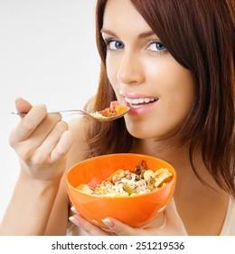 Cheerful beautiful woman eating muslin