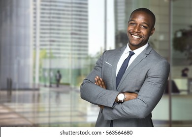 Cheerful big smile from happy executive downtown skyscrapers office workplace