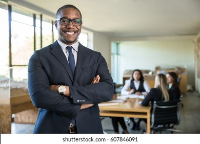 Cheerful big smile from happy executive office workplace with group team meeting in background