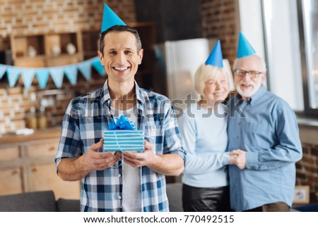Cheerful Birthday Man Joyful Young Holding His Present And Posing With It While