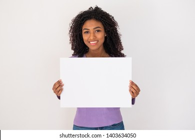Cheerful black woman holding white banner and copy space