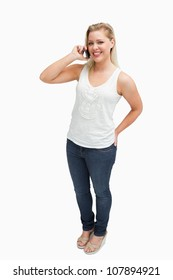 Cheerful blonde woman holding her cellphone against a white background
