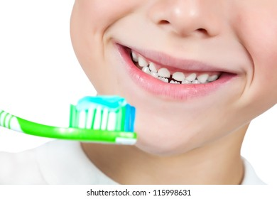 cheerful boy is brushing his teeth isolated on white
