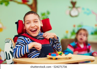 cheerful boy with disability at rehabilitation center for kids with special needs