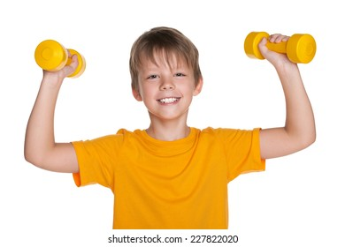 A cheerful boy do exercises with dumbbells on the white background