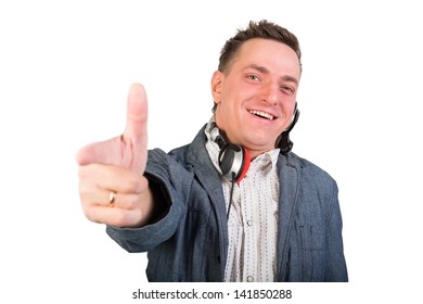 Cheerful boy with headphones around his neck and outstretched arm