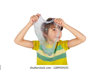 Cheerful boy holding a glitter slime and looking through its hole. Studio shot isolated on white.