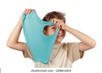Cheerful boy holding a turquoise color slime toy and looking through its hole. Studio isolated on white background.