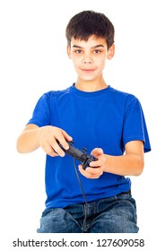 cheerful boy with a joystick playing video games