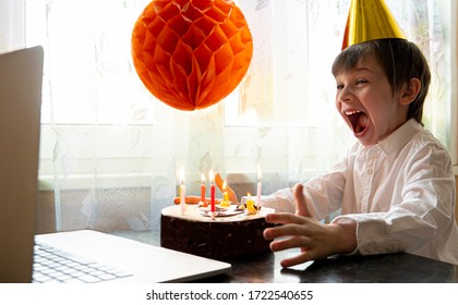 Cheerful boy in mask celebrates his birthday remotely during quarantine