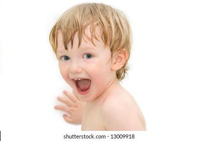 Cheerful boy on white background. In bath.