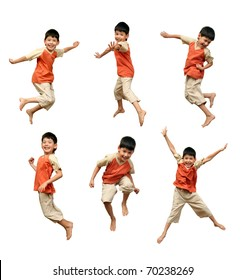 Cheerful boy in an orange shirt jumps up and waves his hands on a white background.