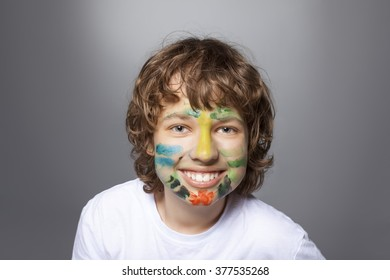 cheerful boy with painted face