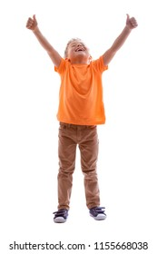 CHEERFUL BOY STANDING AND LOOKING WITH HANDS UP WHILE SMILING ISOLATED ON WHITE BACKGROUND