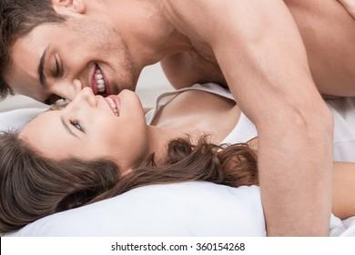 Cheerful boyfriend and girlfriend are making fun
