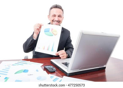 Cheerful broker showing investment results and looking pround on white studio background