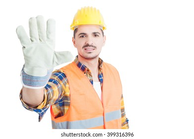 Cheerful builder showing number five or doing  high five gesture isolated on white with copy paste