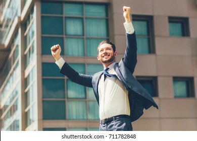 Cheerful Business Man Celebrating Success Outdoors