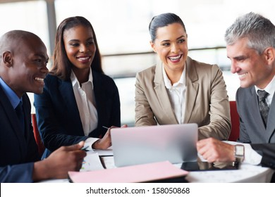 cheerful business people in a meeting at office