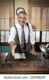 Cheerful businessman giving handshake and smiling, vintage office.