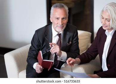 Cheerful businessman sharing points of view with the businesswoman