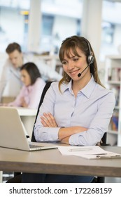 Cheerful Businesswoman in the office on the phone, headset