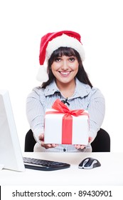 cheerful businesswoman in red santa's hat holding gift. isolated on white background