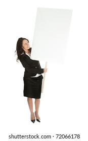 Cheerful businesswomen presenting empty board