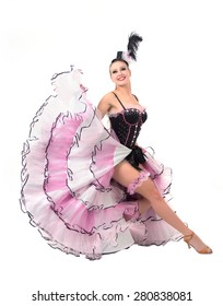 Cheerful cancan dancer posing wearing skirt, corset and hat