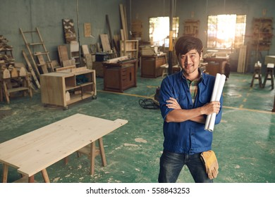 Cheerful carpenter ready to work on new project