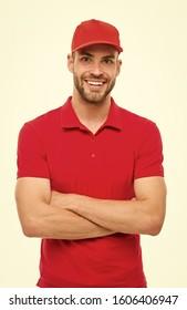 Cheerful cashier. Delivery service. Restaurant cafe staff wanted. Man unshaven hipster wear cap cashier uniform white background. Cashier concept. Salesman cashier career. Hiring shop store worker.