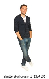 Cheerful casual man standing with hands to pockets jeans and legs crosed isolated onw hite background