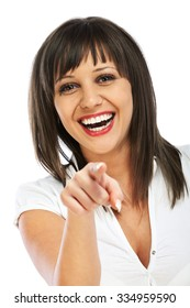 Cheerful caucasian woman pointing at camera, isolated on white background