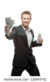 cheerful caucasian young businessman in gray suit holding money isolated on white background