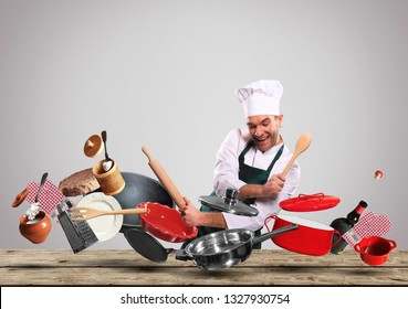 Cheerful chef drumming on pots and pans