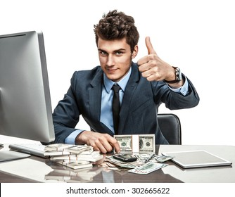Cheerful chief showing thumbs up success sign / modern businessman at the workplace working with computer