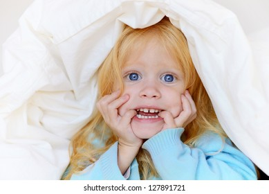 cheerful child in bed