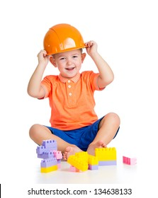cheerful child boy  playing with building blocks toys over white