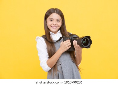 cheerful child girl take photo with digicam, photography.