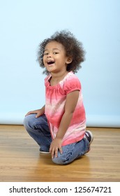 cheerful child kneeling on the floor