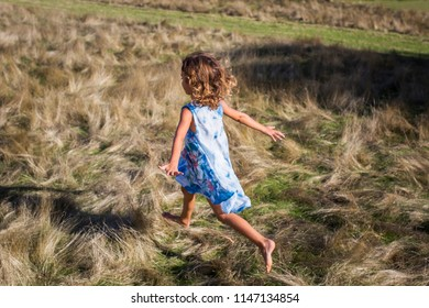 cheerful child running on the field