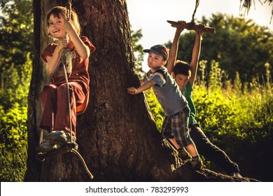 Cheerful children having fun outdoors in forest during summer holidays in countryside symbolizing happy carefree childhood