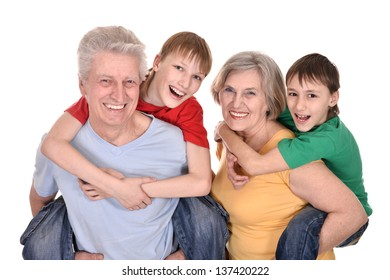 cheerful children and their grandparents on a white background
