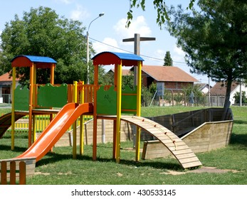cheerful children's playground is located in a wooden board